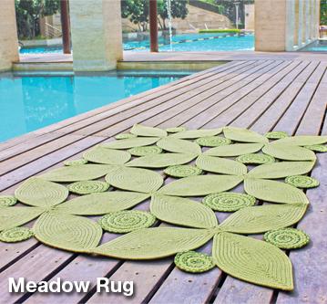 meadow braided rugs used by pool